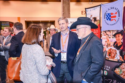 (right to left) USMEF Chair Dennis Stiffler and Assistant VP for International Marketing Greg Hanes speak with Texas cow-calf producer Jackie Means, a member of the Cattlemen's Beef Board and the Beef Checkoff Program's Export Growth Committee, at the Cattle Industry Annual Convention in Phoenix