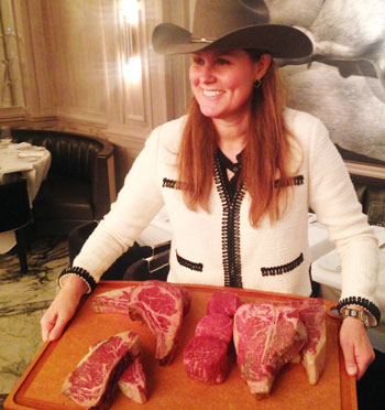 Suzanne Strassburger of Strassburger Steaks explains high-quality cuts of U.S. beef to the team of Japanese food journalists