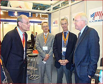 (from left) USMEF's Thad Lively, Yuri Barutkin and John Brook visit with U.S. Ambassador to Russia John Beyrle at World Food Moscow
