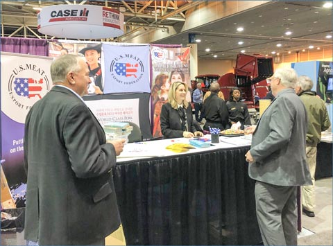 Tammy Connolly, USMEF director of international trade programs, greets visitors at the USMEF trade show booth at the American Farm Bureau Federation Convention in New Orleans