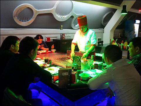 "A chef at one of Tashkent's Japanese-style restaurants participating in ""Days of American Steak"" prepares a dish using U.S. beef"