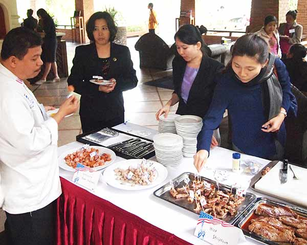 Myanmar foodservice and retail representatives enjoy U.S. pork and beef samples at a tasting session