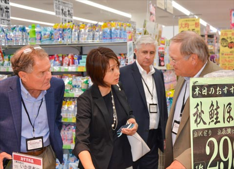 Heartland Team members discuss U.S. beef and pork retail promotions with Tazuko Hijikata (center), consumer affairs senior manager for USMEF in Japan