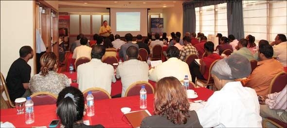 USMEF retail consultant Dave Ferrelli addresses a packed house in Trinidad
