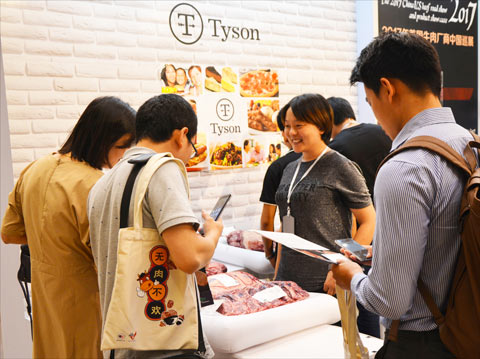 Buyers at the Tyson Foods booth in Shanghai