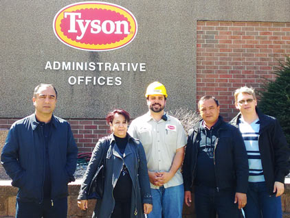 Veterinary officials from Uzbekistan visit the Tyson Foods pork plant in Storm Lake, Iowa