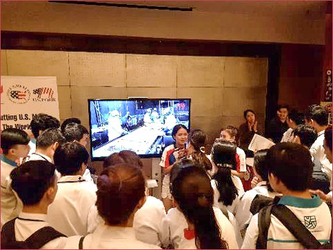 """USMEF staff members engage Vietnamese chefs at the """"U.S. Pork Event Corner"""" at the Saigon Professional Chef's Guild U.S. Food Products Showcase"""