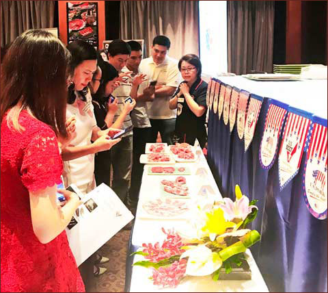 Participants in the U.S. Red Meat Quality and Application Workshop in Vietnam check out cuts of U.S. pork and beef