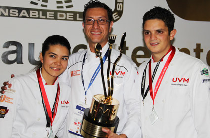Winning team members Gabriela Pena (left) and Eduardo Villagran (right) from the UVM Guadalajara South campus are pictured with their coach, Executive Chef Hector Davalos