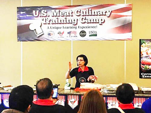 USMEF ASEAN Director Sabrina Yin conducts a cutting demonstration at the U.S. Meat Culinary Training Camp in the Philippines