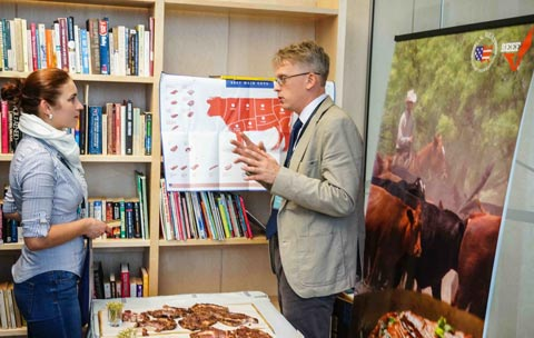 USMEF Representative Yuri Barutkin answers questions from a prospective buyer and offers U.S. beef samples at the U.S. Food Showcase in Latvia
