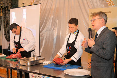 USMEF Representative Yuri Barutkin (far right) answers questions from Uzbek chefs at a U.S. beef cutting demonstration