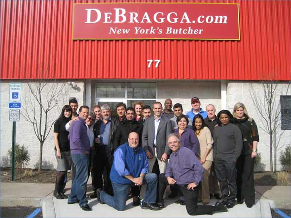 "The Bermudan restaurant team outside ""New York's Butcher"""