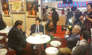 """Takemichi Yamashoji (left), USMEF director in Japan, is interviewed by the TV show """"World Business Satellite"""" at FOODEX"""