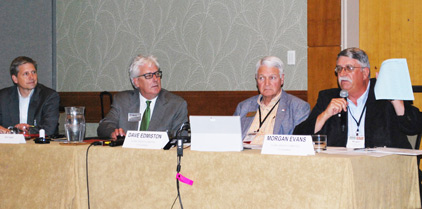 Idaho cattleman Morgan Evans (far right), co-chair of the Global Growth Committee, explains the AR tactic scoring system