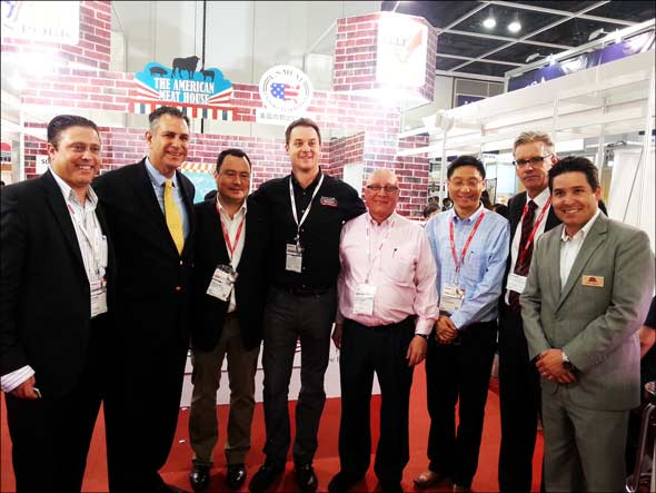(l-r) Eric Brandt, Dept. of Commerce Under Secretary for International Trade Francisco Sanchez, Hong Kong importer Oliver Win, Harris Ranch's Chris Ross, importer Peter Fransson, David Choi of JIT, USMEF's Joel Haggard and Derek Alarcon of Superior Farms Lamb