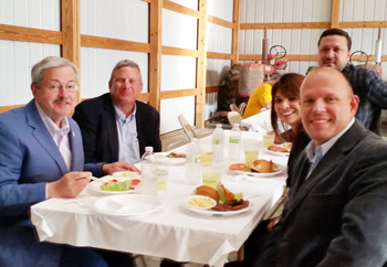 Iowa Governor Terry Brandstad (far left) joins a USMEF-led team of buyers from Mexico and Central America for dinner  at the farm of Gordon Wassenaar, past chairman of the Iowa Corn Promotion Board