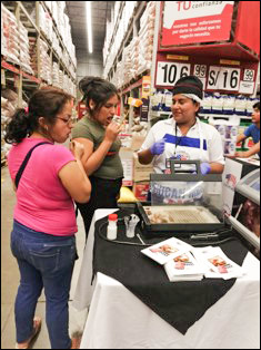 Customers in Peru sample U.S. pork ribs during in-store promotions conducted by USMEF and the Makro wholesale chain