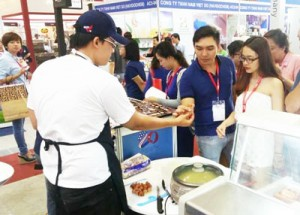 Visitors sample U.S. meat products at the USMEF booth